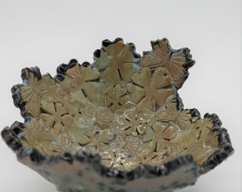 Bowl, flowers and butterflies spiral around this stunning unique bowl.