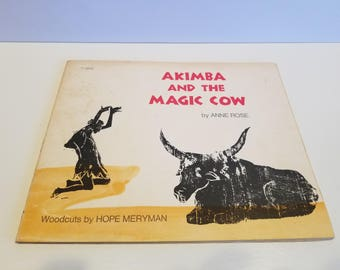 Akimba and the Magic Cow,  By Anne Rose, Woodcuts by Hope Meryman, Copyright 1976, Published by Scholastic Book Services