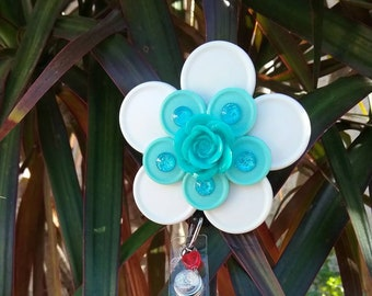 White/aqua flower badge holder