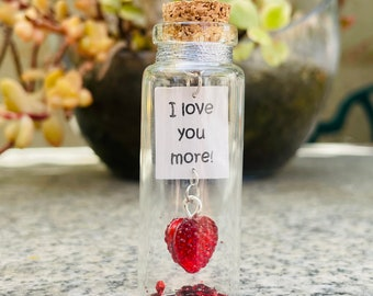 Message in a tiny bottle. I love you more. Mini glass bottle.