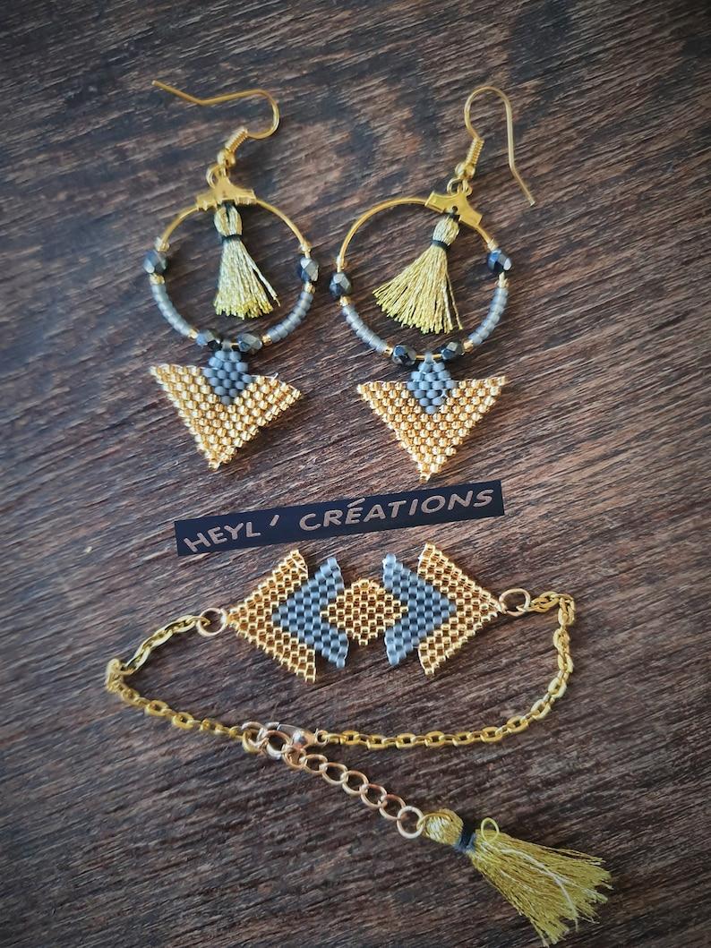Gold and grey pompom series adornment