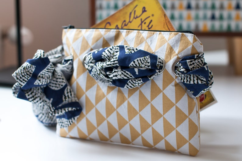 A stunning design for a handmade fabric pouch with artful style by Madame Gustave Couture. A few favorite Finalists for the Etsy Awards are spotlighted in this story with inspiring photos on Hello Lovely.