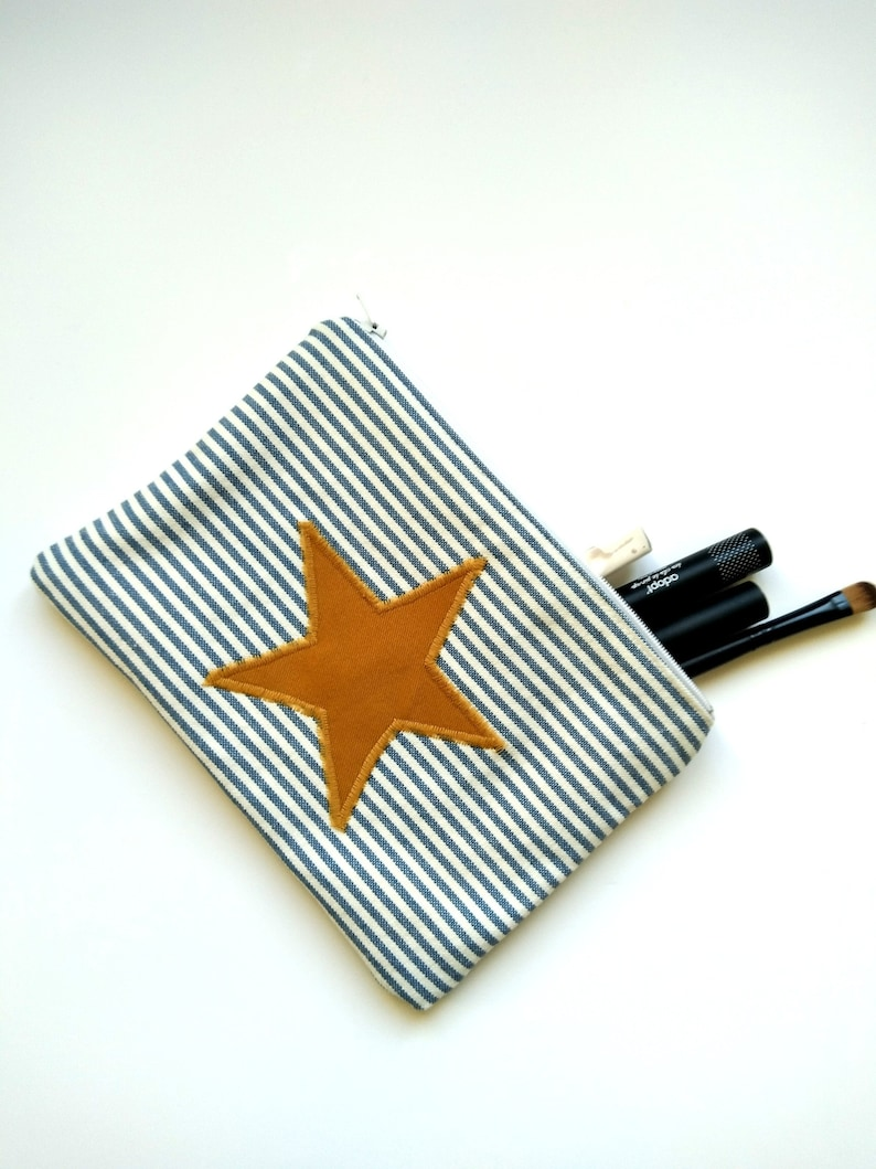 Beautiful handmade pouch with stripes and star by Madame Gustave Couture on Etsy. A few favorite Finalists for the Etsy Awards are spotlighted in this story with inspiring photos on Hello Lovely.