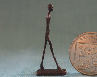Bronze figure of a walking man after Giacometti