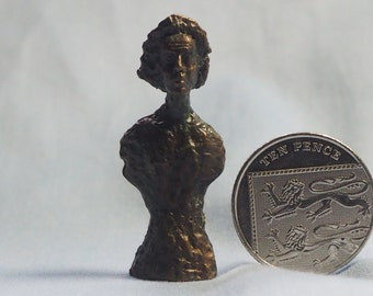 Miniature bronze bust after Giacometti