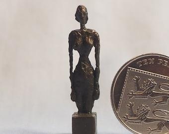 Miniature bronze Giacometti woman