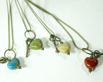 """One Small heart and key pendants, 30"""" antique bronze chain"""