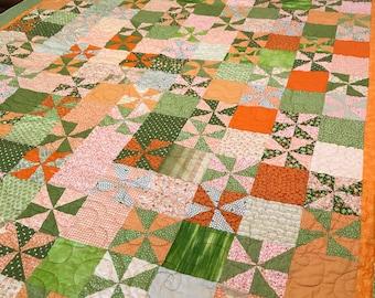 Orange and green lap quilt, blanket, cotton, pinwheels
