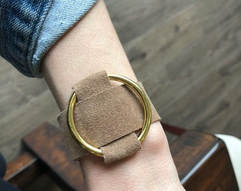 Sandy brown suede and medium gold ring crisscrossed cuff