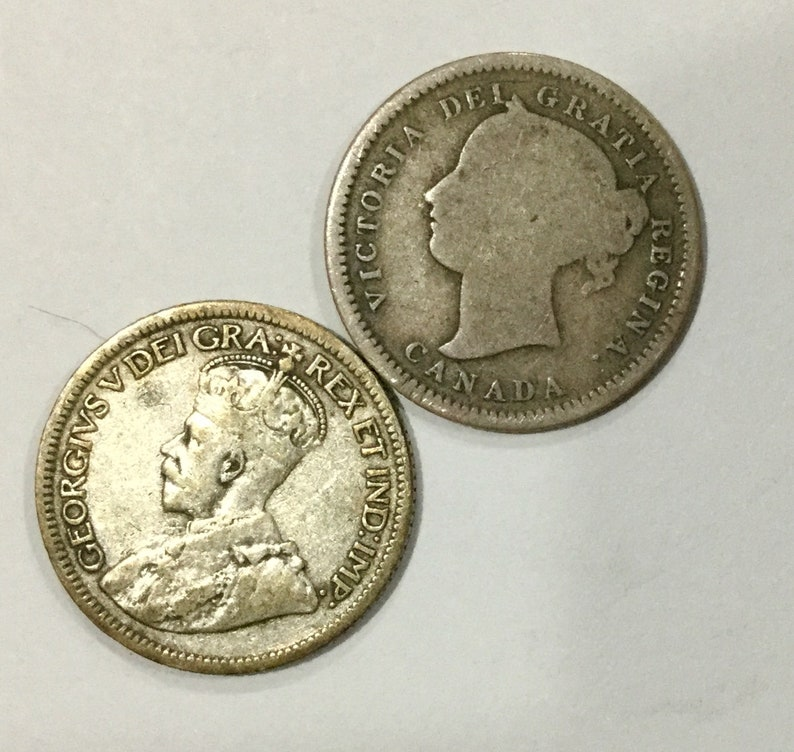 1947 Canada Silver 25 Cent Average Circulated coin for your collection.