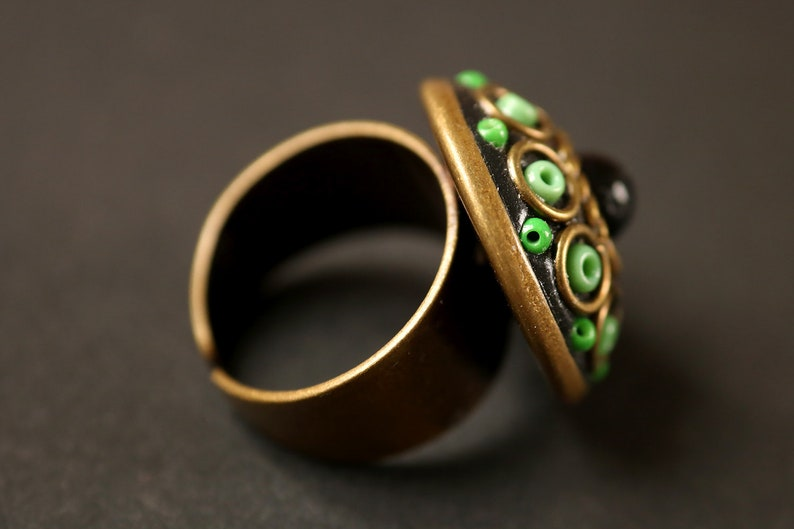 Mystical green and black ring round, adjustable, magical, orient inspiration, circle, glass beads, rockery beads gift idea.