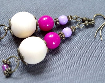Purple earrings with wooden beads.