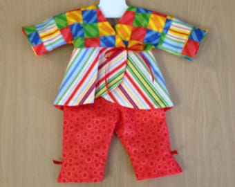 This colorful playsuit is handmade to fit the 18 inch American Girl like dolls.  Includes a wrap jacket and capri pants.