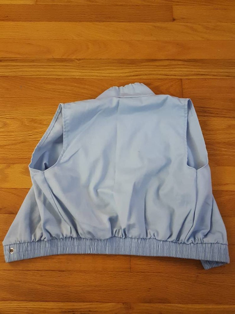 Retro light blue snap button up hoodie-less vest with neck drawstring