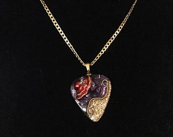 Red hat guitar pick necklace