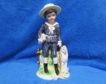 Vintage boy with dog porcelain figurine