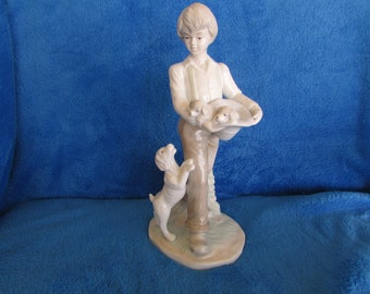 Vintage boy with dog and puppies porcelain figurine