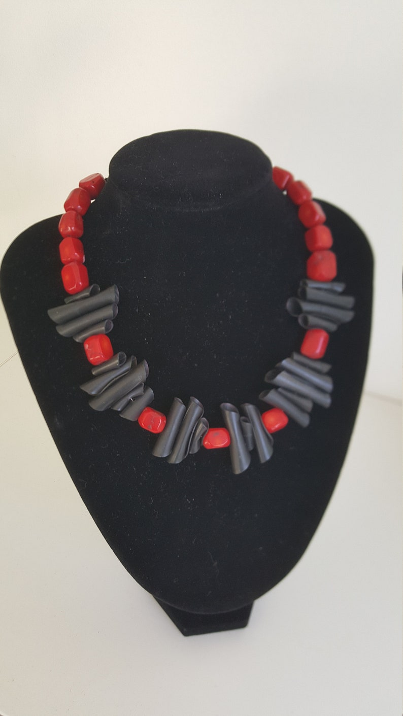 Upcycling necklace in black and red made from inner bike tube and recycled beads