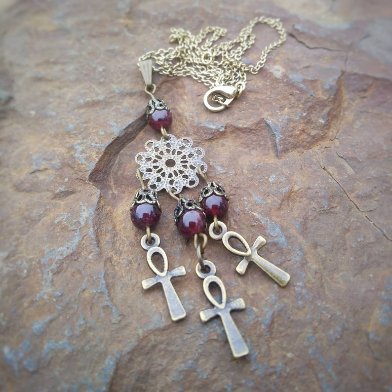 Garnet and Ankh Charm Antique Brass Finish Necklace