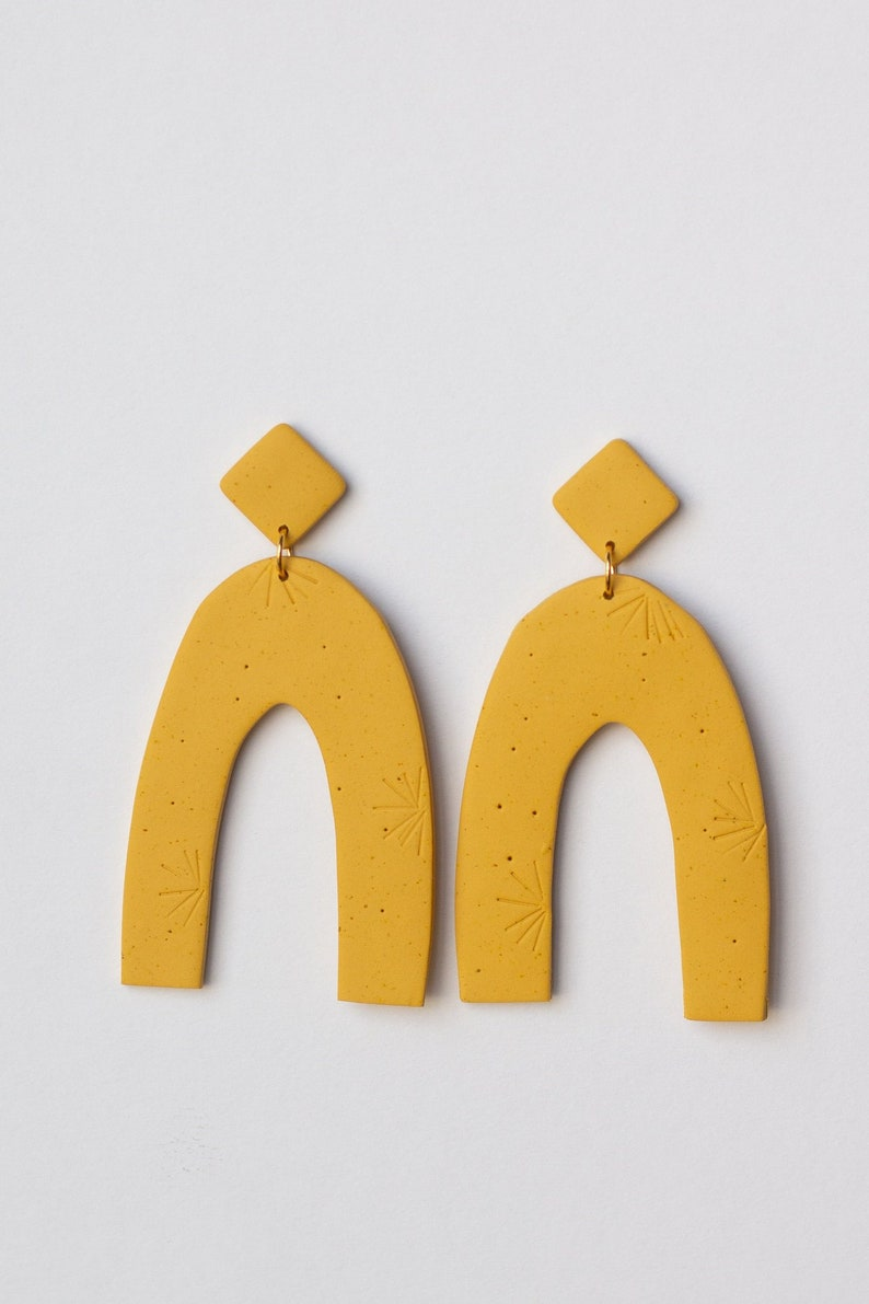 aaaae5595aaa5 Arch Earrings - Mustard