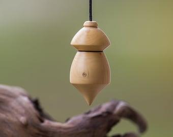 Pendulum dowsing boxwood