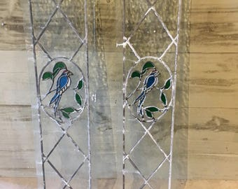 a pair of stained glass victorian style panels with bird feature design
