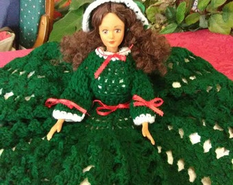 Vintage doll named Shirley. Wearing a green crochet dress. Named after the lady who made this dolls dress.