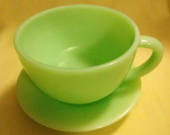Vintage jadite coffee cup and saucer. Clean, never used, no stains.