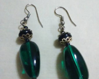 Vintage green and gold dangler earrings. Round and oblong green bead with gold accent beads.