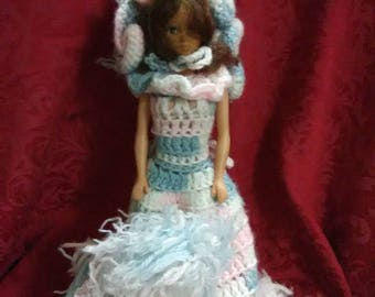Vintage 1970's plastic doll used to cover a roll of toilet paper