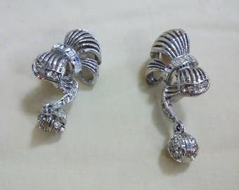 Vintage silver tone metal rhrinestones with dangling ball clip on earrings.