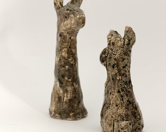 Two spring hares, ceramic
