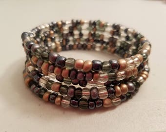 Gray, champagne and silver beads coil bracelet