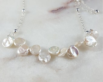 11 piece freshwater pearl necklace on a dainty silver bead chain