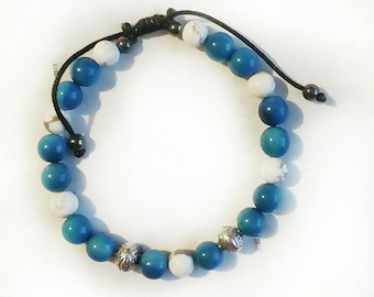 Mens Tagua bracelet sky blue, 925 sterling silver beads and veined white howite. Sliding clasp decorated with two hematite beads.