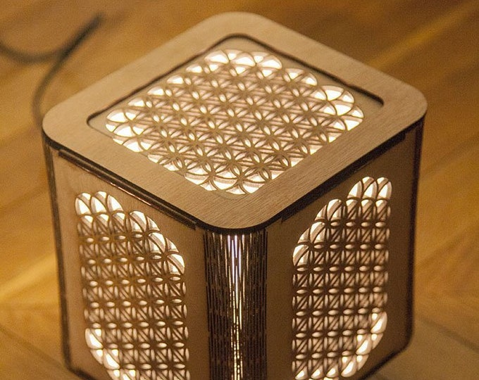 Japanese-style wooden lamp With flower of life sacred geometry. Laser cutting.