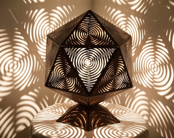 Antchae or wooden lampshade, icosahedron platonic shape, optical illusion drawing with shadow projection. Laser cutting.