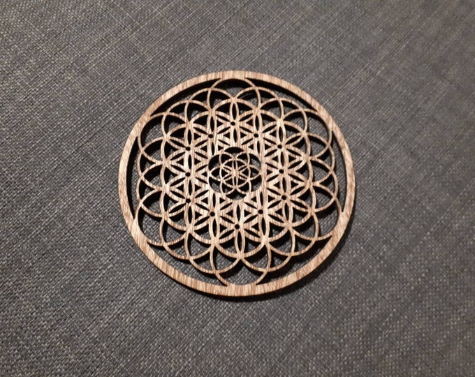 Wooden coasters pattern flower of life. Sacred geometry, relaxation tea. Handcrafted laser cutting.