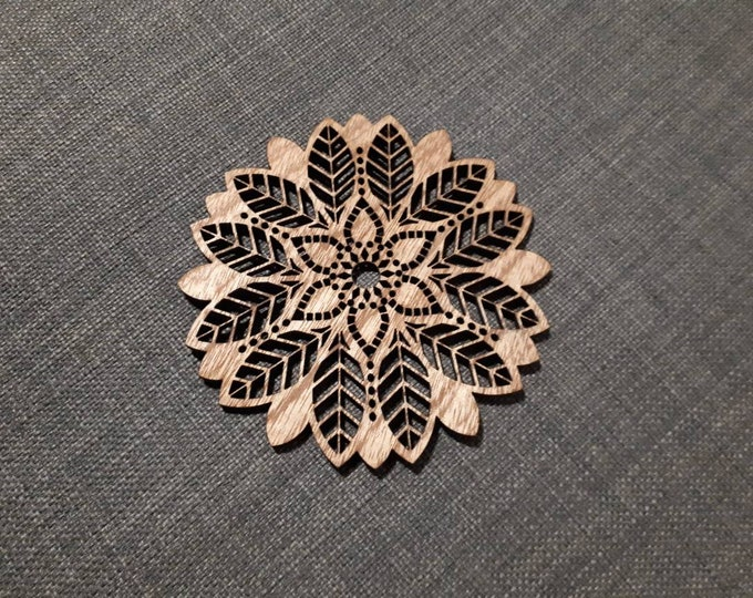 Mandala pattern wooden coasters. Sacred geometry, relaxation tea. Handcrafted laser cutting.