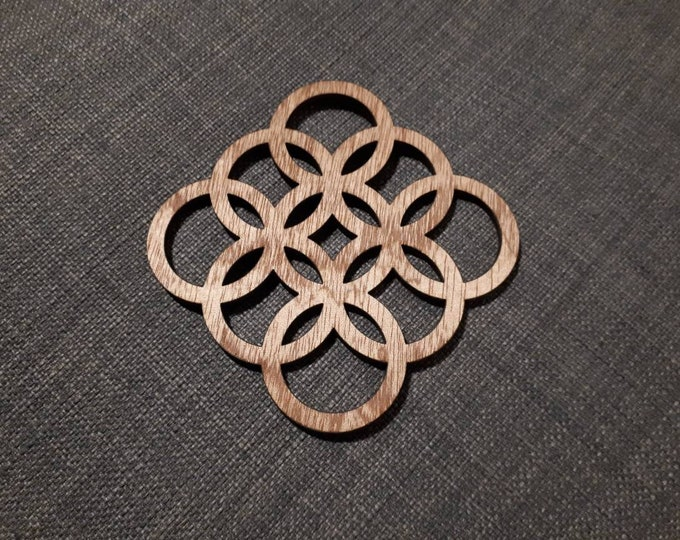 Wooden coasters geometric pattern, relaxation tea. Handcrafted laser cutting.