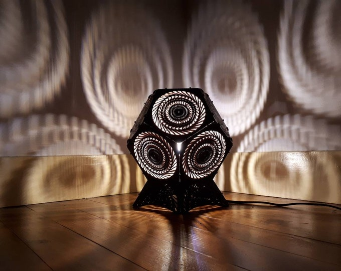 Wooden lamp - Dodecahedron shape kynetic geometry with projection of artificial laser light shadows