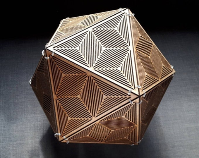 Wooden suspension lamp, platonic shape icosahedron with optical illusion drawing. Laser cutting.