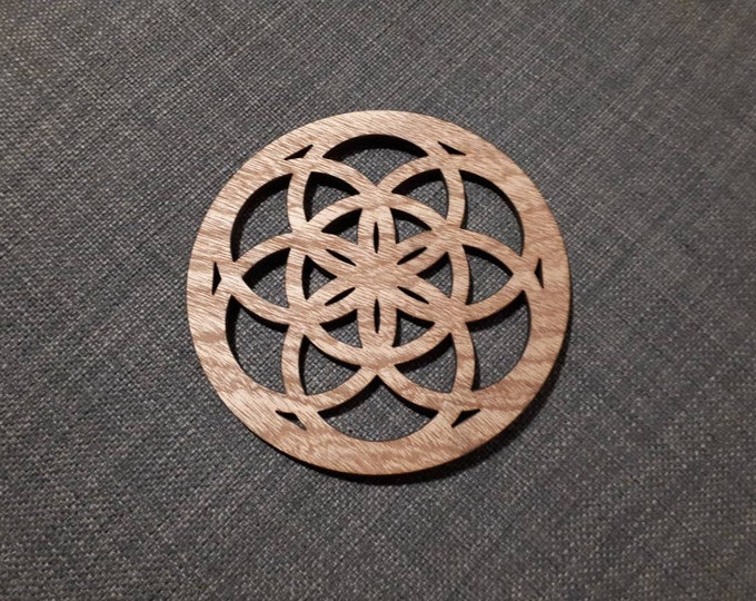 Wooden coasters pattern mandala flower of life. Sacred geometry, relaxation tea. Handcrafted laser cutting.