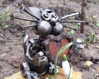 Сat with a heart. Sculpture from metal.