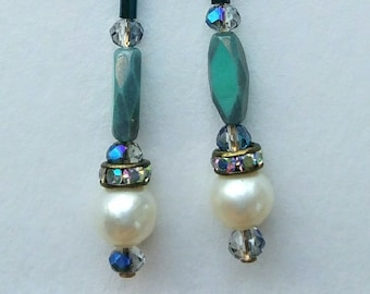 9. Long, dangle pearl earrings