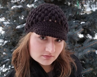 This is a handmade crochet news boy hat in a puff stitch. Made in an adult size.