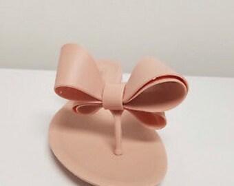 5b2b3ea0a Nude Bow Jelly Flip Flops