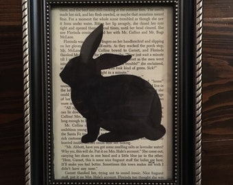 """A unique framed """"Jump to Read"""" rabbit silhouette on recycled book page."""