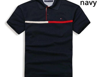 46e584a6 Mens Tommy Hilfiger Polo Size Large. Originally 65 (USD) All cotton quick  dry. Very dark navy with red/white trim.