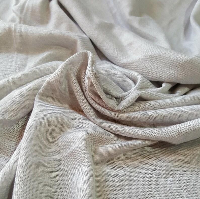 e880230cda7 Rayon spandex knit fabric light gray . By the yard . | Etsy